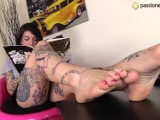 Barefoot Tattoed Girl Flexes Her Toes